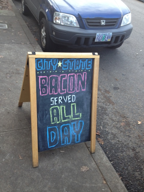 "Sandwich board sign outside City State Diner. ""Bacon Served All Day"""
