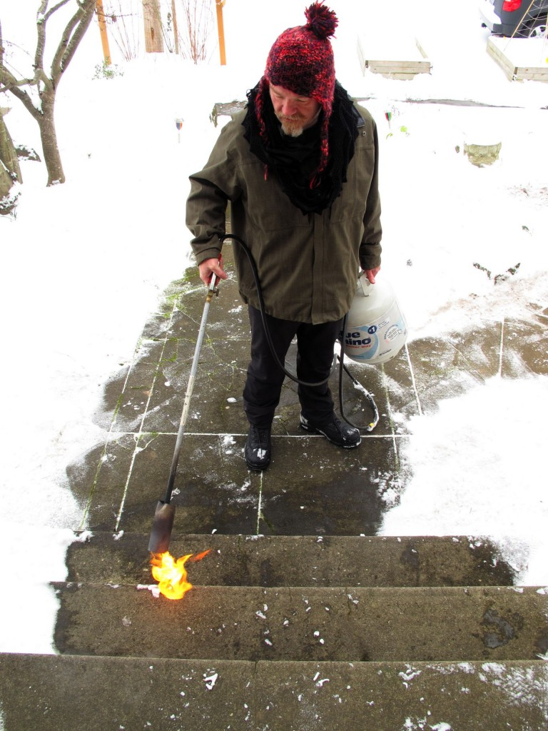 Melting snow with a flamethrower